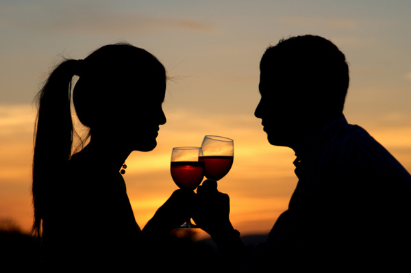 Couple at sunset with wine