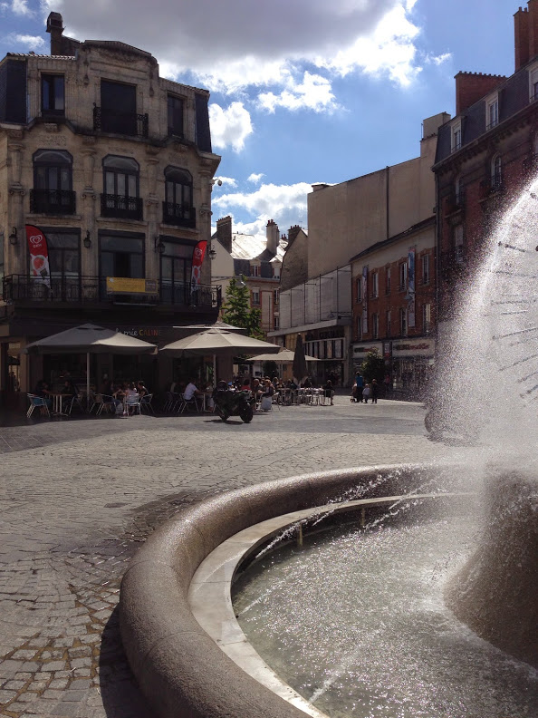 A view of the center of Reims with the Sube Fountain in the foreground - This monumental fountain was erected in the middle of the Place d'Erlon by André Najoux in 1906 thanks to August Subé's generosity.